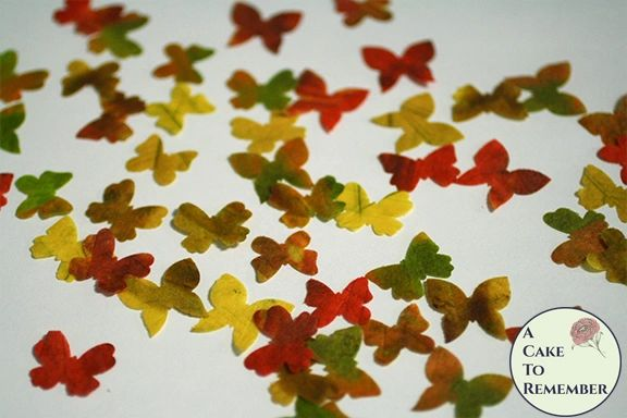 48 small edible cake decorating butterflies in autumn leaf colors. Color on both sides
