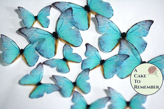 12 teal edible butterflies for wedding cake toppers.