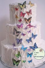 27 rainbow edible wafer butterflies for cake decorating, assorted sizes.