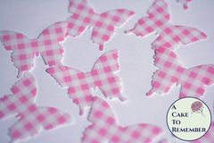 24 pink gingham edible butterflies for cake decorating.