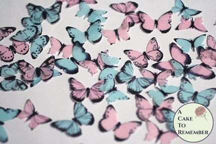 48 small pink and blue edible butterflies for cupcake toppers