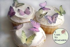 24 small edible butterflies, pink and yellow mini cupcake decorations