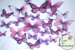 26 pale pink edible butterflies for a rustic wedding cake