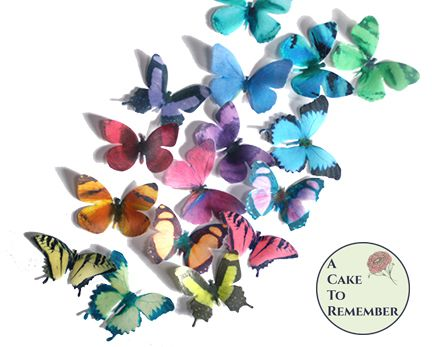 16 edible cake butterflies in rainbow colors