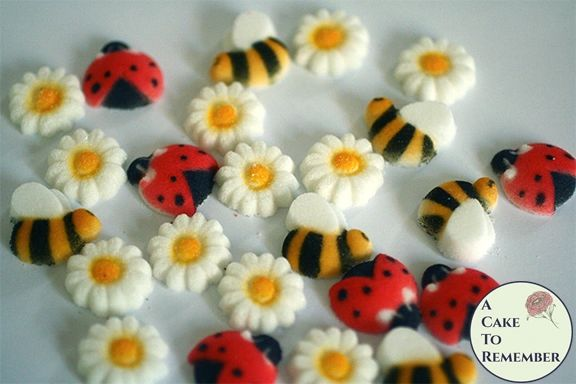 Bees, ladybugs, and daisies edible sugars for cupcakes