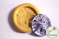 small sand dollar mold for cake decorating or polymer clays. M5159