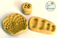 Flexible silicone pine cone mold set.