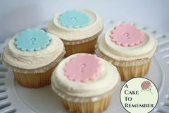 Edible fondant gender reveal party cupcake toppers