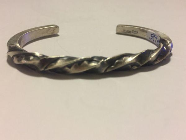 Signed heavy satin sterling silver twist/stamped bracelet