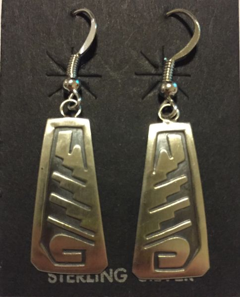 Hopi sterling silver relief dangle earrings.
