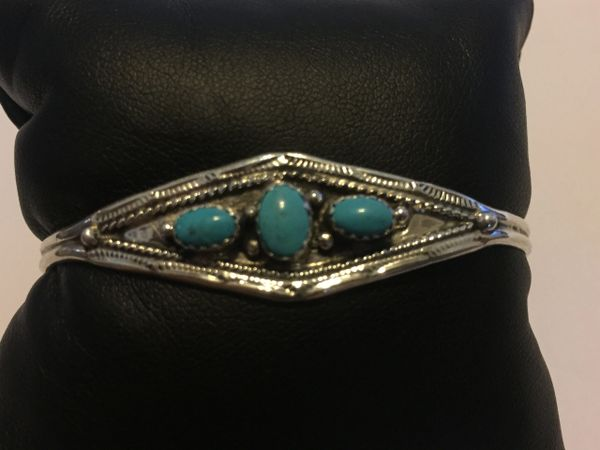 Signed 3 oval turquoise stone bracelet. Sterling silver