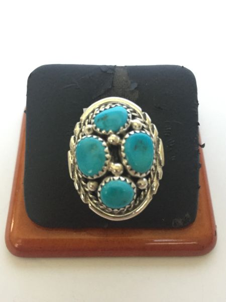 Signed sterling silver & turquoise ring. 4 stones.