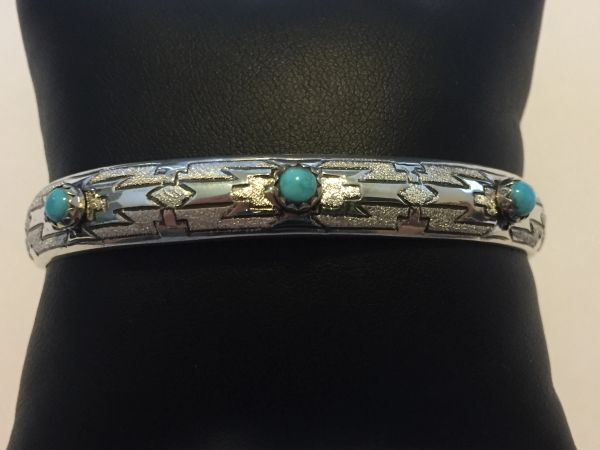 Signed Navajo bracelet. Etched Sterling silver & turquoise.