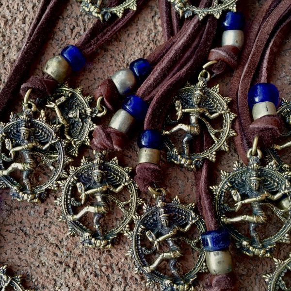 BRASS SHIVA THE DESTROYER NECKLACE on AMERICAN DEER SKIN