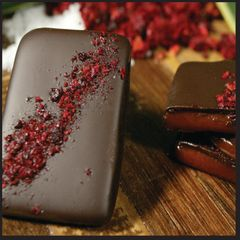 Organic cherries sprinkled over coconut milk caramels, enrobed in organic 85% cacao. Three bars per order.