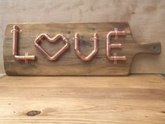 Copper pipe love sign