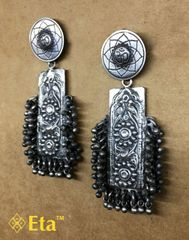 Silver tribal earring