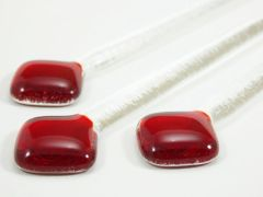 Red and clear glass swizzle sticks