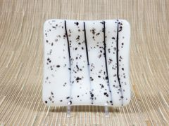 Black patterned white glass small square centred plate