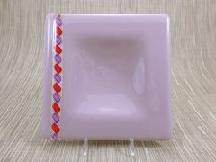 Mauve glass square centred plate with twisted red/purple/white strip