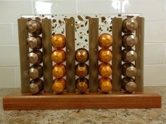 Chocolate and clear glass coffee pod stand with Jarrah timber base