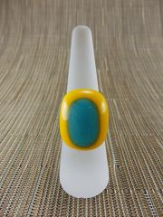 Yellow glass ring with light blue centre