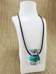 Turquoise blue and clear glass pendant with black pattern