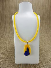 Yellow glass pendant with blue pattern