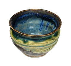 teabowl, blue interior with brown rim, blue yellow and brown exterior