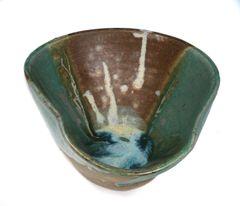 wonky bowl, dark green, brown blue brown white interior