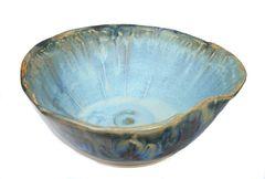 large wavy bowl, blue interior, brown rim, brown and black exterior