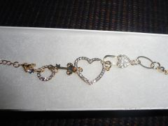 18K Gold plated, gold and white Swarovski Elements heart and key link Bracelet.