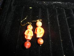 gold plated Orange skull w/glass beads