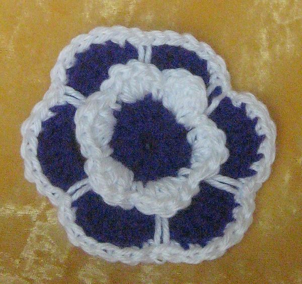 Hat accessory 35 inch flower with 6 petals crocheted in purple hat accessory 35 inch flower with 6 petals crocheted in purple and trimmed in white and has a clip on back 0381 mightylinksfo