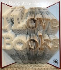 "READY TO POST ""I love Books"" hand folded into the pages of a preowned hard backed book"