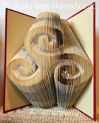 Triskelion : : Hand folded into the pages of a book