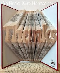 """""""Thanks"""" folded in to the pages of a book :"""
