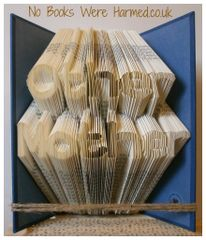 """""""Other Mother"""" : : Hand folded in to the pages of a book"""