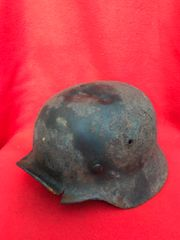 German Soldiers M35 helmet with a lot of paintwork,liner ring with Battle damage,solid relic recovered from the Hurtgen Forest in Germany the battlefield of September to December 1944