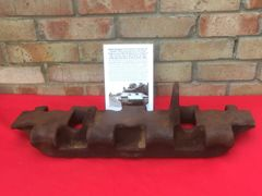 Battle damaged track link from German SS Panther tank recovered many years ago from scrap yard that cleared Hill 112 near Caen in Normandy 1944 summer battlefield