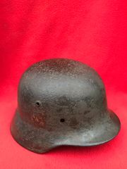 German soldiers double decal M40 helmet which is a nice solid relic with green paintwork remains from the Ardennes Forest from the battle of the Bulge in the winter 1944-1945