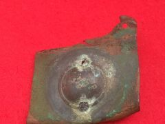 German soldiers brass belt buckle recovered from an old German trench line near the village of Mametz on the Somme battlefield