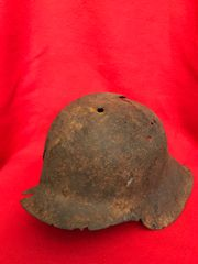 German Soldiers M35 helmet with lots of Battle damage,solid relic recovered from the Hurtgen Forest in Germany the battlefield of September to December 1944