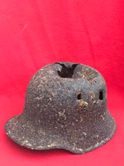 German M17 helmet with lots of blast damage recovered during the Battle of Le Hamel on the 4th July 1918,Australian and American offensive on the Somme battlefield
