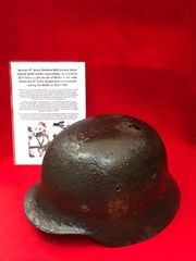 German 9th Army soldiers M40 double decal,leather liner,chin strap helmet recovered from a Lake South of Berlin in the area the 9th Army fought,surrendered in April 1945 during the battle of Berlin