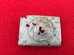 German Panzer Lehr Division soldiers belt buckle recovered from a pit of Fallschirmjager and Army equipment buried on Hill 192 the battle of St Lo on the Normandy battlefield of 1944