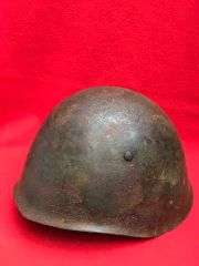 Italian soldiers M33 helmet size 58 with green paint remains recovered from the Alps Mountains from the Italian invasion in June 1940 the battle against the French Army