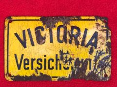 Old yellow and black metal German street sign found on a local fair around the town of Spa in Belgium
