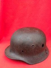 German Krigsmarine soldiers M35 helmet with paintwork remains,battle damage very nice condition found on a brocante near Lorient possibly part of uboat base defence