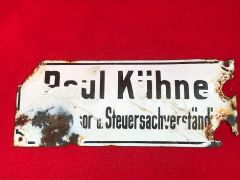 Old large white and black metal German street sign found on a local fair around the town of Spa in Belgium